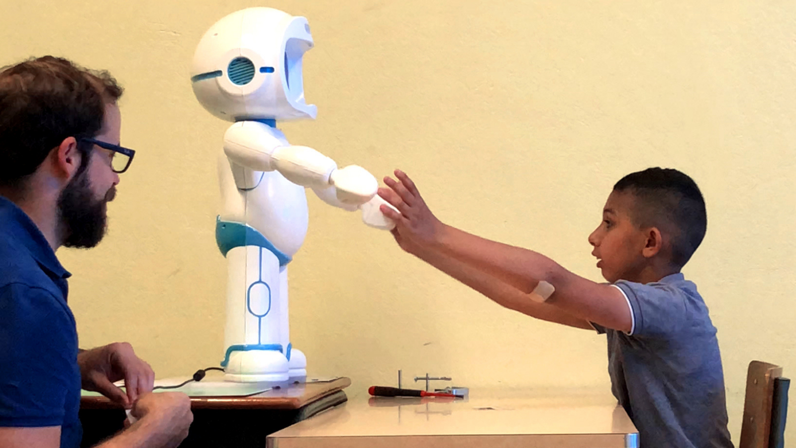 Can a robot open new doors to teach social interaction to children with autism?